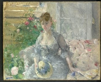 Young Woman Seated on a Sofa (ca 1879) | Berthe Morisot | oil painting