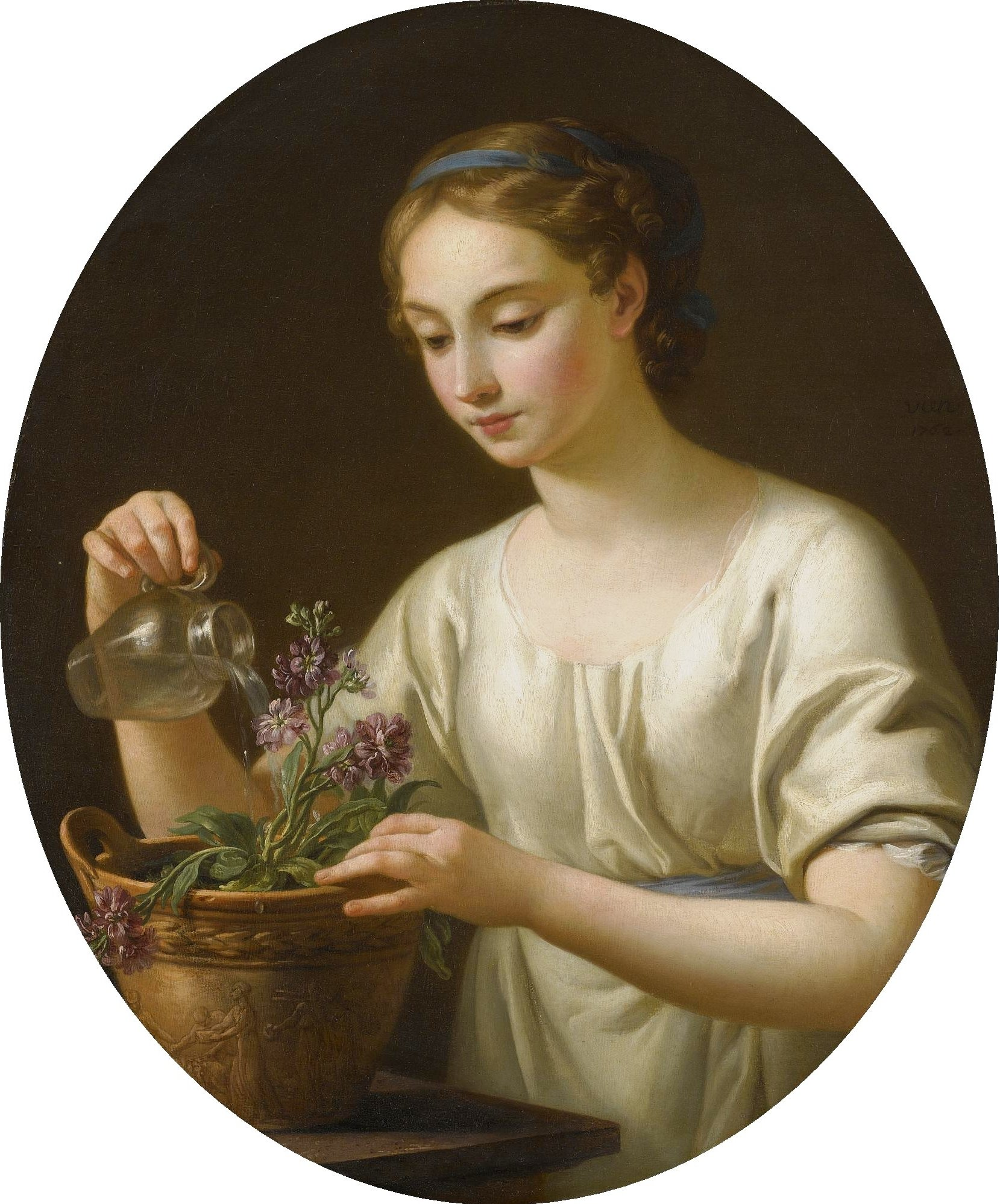 A Young Woman Watering A Pot Of Flowers
